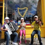 From left: Jarlath (12), Shania (9) and Eoin (14) Holland from Co Tyrone take part in the Fleadh. (Photo: Laura Hutton/Photocall Ireland)