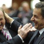 Enda Kenny and Nicolas Sarkozy playfully bopping each other on the head and arm to show that a financial crisis is no reason to fall out. (AP Photo/Geert Vanden Wijngaert/PA)