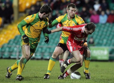 Conor McManus (middle) pictured with Donegal's Patrick McBrearty and Derry's Brian McCallion in a Dr McKenna Cup game earlier this year.