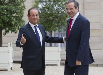 Francois Hollande (left) welcomes Antonis Samaras to Paris.
