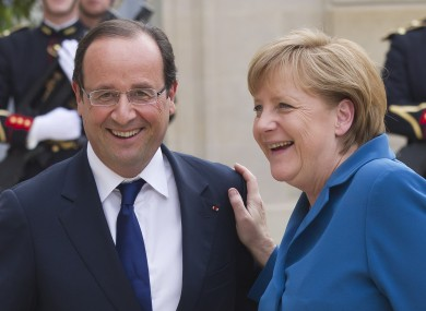 File photo of Francois Hollande and Angela Merkel