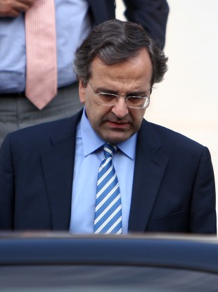 Greece's Prime Minister Antonis Samaras leaves Maximos mansion after his meeting with the other political leaders of the coalition government in Athens.