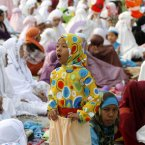 An Indonesian girl yawns as she attends Eid al-Fitr prayers at Sunda Kelapa port in Jakarta, Indonesia. (AP Photo/Tatan Syuflana/PA)