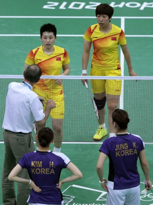 An official intervenes during the match between China and South Korea at Wembley Arena in London.