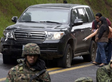 An armoured US embassy vehicle attacked by unknown assailants is checked by security personnel near Tres Marias, Mexico yesterday.