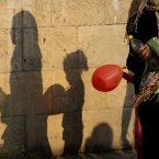 An Egyptian girl holding a balloon and her mother cast shadows on a wall after the feast prayers at Amr Ibn Al-As mosque in Cairo. (AP Photo/Amr Nabil/PA)