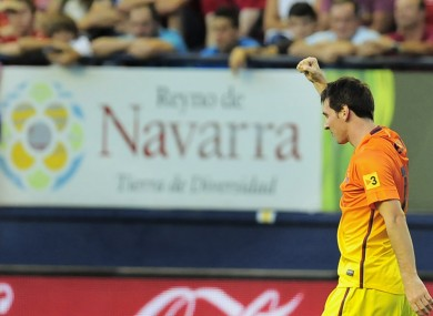 F.C. Barcelona's Lionel Messi from Argentina, celebrates after scoring against Osasuna.