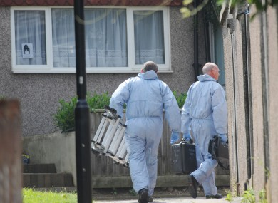Forensic police officers at the home of Christine Sharp, grandmother of Tia Sharp, today