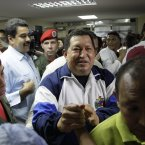 President Hugo Chavez greets supporters during a visit to injured people at the Rafael Calle Sierra's public hospital in Punto Fijo on Monday after the refinery explosion. (AP Photo/Ariana Cubillos/PA)