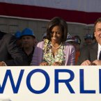 In this June 14, 2012 file photo, President Barack Obama, first lady Michelle Obama, and New Jersey Governor Chris Christie, sign the steal beam. (AP Photo/Carolyn Kaster, PA File)