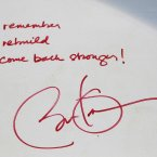 President Barack Obama's signature and message. (AP Photo/Mark Lennihan/PA)
