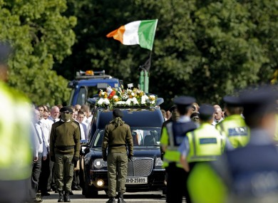 Mourners and Gardaí at last weekend's funeral for Alan Ryan.