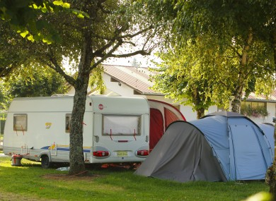 The caravan and tent used by the family while on holiday at the Le Solitare du Lac campsite