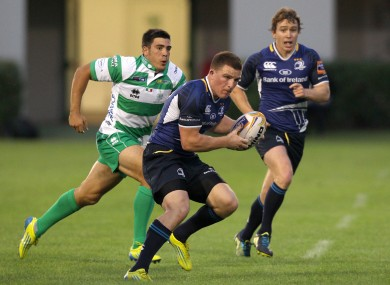 Leinster's Andrew Conway escapes from Edoardo Gori of Treviso.