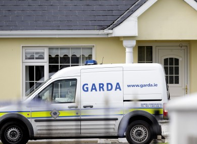 Gardaí outside the house in Harrison Place, Charleville, Co Cork on Monday.