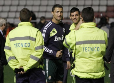 Cristiano Ronaldo poses for a photo with stadium staff after the game is called off last night.
