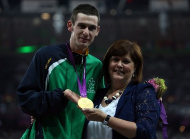 Ireland's Michael McKillop receives his Gold medal in the Mens 1500m - T37 from his mother Catherine at the Olympic Stadium.
