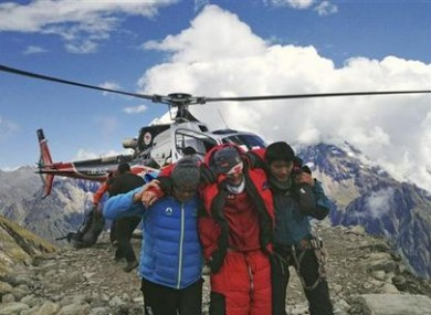 In this photo provided by Nepalese airline Simrik Air, an injured victim of an avalanche is rescued at the base camp of Mount Manaslu in northern Nepal