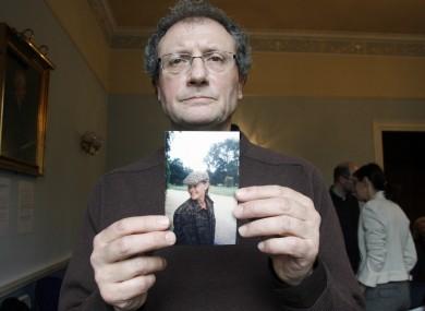 Holding an image of Sophie Toscan du Plantier is her uncle Jean-Pierre Gazeau