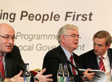 Environment Minister Phil Hogan, Tánaiste Eamon Gilmore and Taoiseach Enda Kenny at the announcement of local government reforms yesterday.