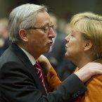 Angela Merkel puckers up to Luxembourg's Prime Minister Jean-Claude Juncker. Well, we suppose he isn't in her bad books. (AP Photo/Geert Vanden Wijngaert)