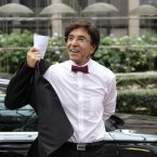 Belgium's Prime Minister Elio Di Rupo arrives in style for the EU summit in a wine coloured bow-tie. Dress sharp. Feel sharp. (AP Photo/Yves Logghe)