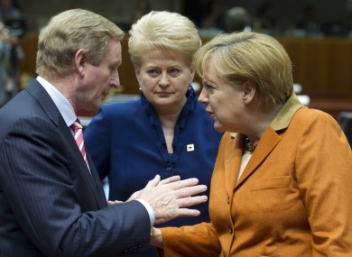 Enda Kenny speaking with Angela Merkel during the European Council meeting in Brussels on Thursday. Lithuanian president Dalia Grybauskaite looks on.