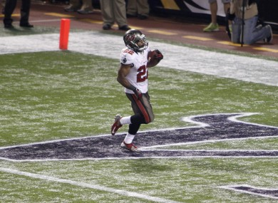 Buccaneers running back Doug Martin runs in the end zone after scoring on a 64-yard TD reception.