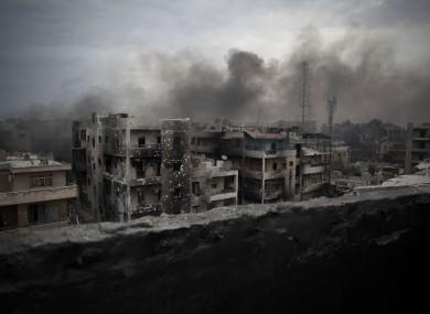 Smoke rises over Saif Al Dawla district, in Aleppo, Syria - 2 Oct 2012.