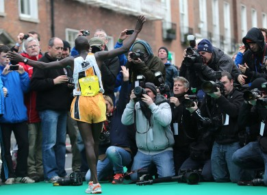 Ndungu poses for the press after winning today's race.