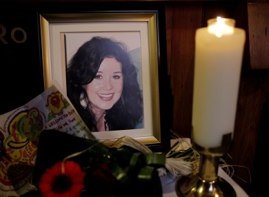 A candle burns during a memorial mass for Jill Meagher