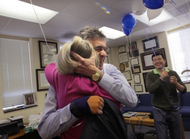 Robert Lefkowitz hugs his administrative assistant of 35 years Donna Addison in his office after hearing that he had won.