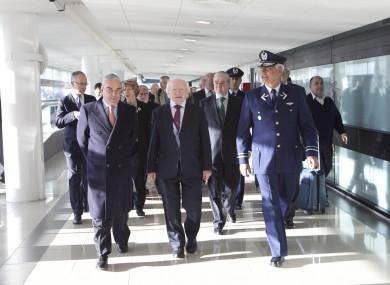 President Higgins arriving to Santiago Arturo Merino Benitez Airport with Ambassador James Sinclair Manley (left) and Brigadier General Ronaldo Mercado , General Commander of the Air Garrison yesterday morning.