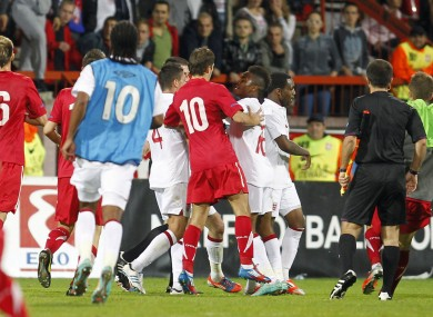 A brawl erupts at the end of England's U21 match against Serbia.