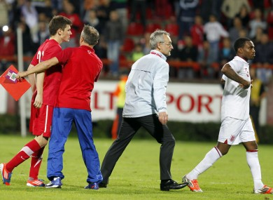 Serbian player Milos Ninkovic, left, and England player Danny Rose, right, react during their 2013 UEFA European Under-21 Championship play-off.