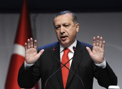 Turkey's prime minister Recep Tayyip Erdogan addresses a forum in Istanbul. Turkey and Syria have each banned flights coming from the other country.