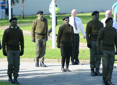 Real IRA members stand to attention at the funeral of Alan Ryan.