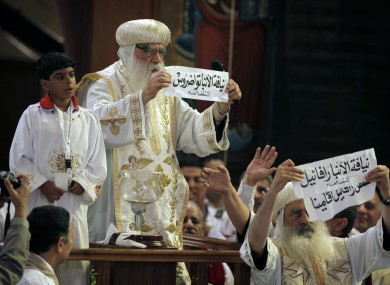 Acting Coptic Pope Pachomios, center, displays the name of 60-year-old Bishop Tawadros, soon to be Pope Tawadros II