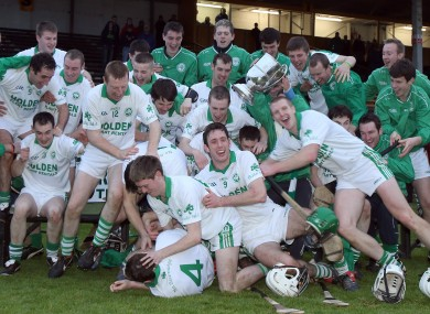 Ballyhale Shamrocks players celebrate with the cup.