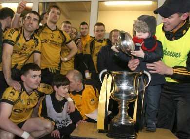 Brendan Devenny and his son Matthew inspect the cup before it is presented to St Eunan's captain Michael Martin.