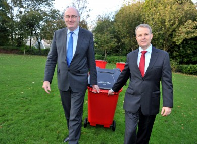 Minister Phil Hogan with a representative from the City Bin Co
