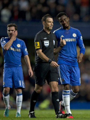 Clattenburg and Mikel during the match in question.