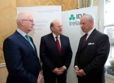 Barry O'Leary CEO, IDA Ireland, Minister for Finance, Michael Noonan, Jeffrey Tessler, CEO Clearstream at the announcement today.