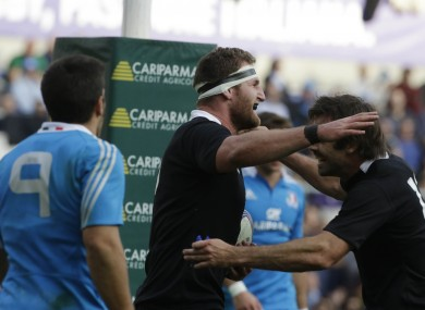 New Zealand's Kieran Read, center, celebrates with teammate Conrad Smith after scoring a try.