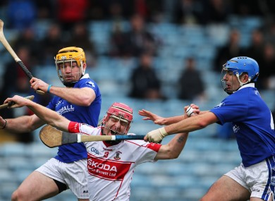 De La Salle's John Mullane under pressure from Padraic Maher and David Maher of Thurles Sarsfields.