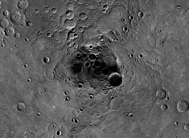 A 68-mile-diameter crater, large indentation at center, in the north polar region of Mercury which has been shown to harbor water ice.