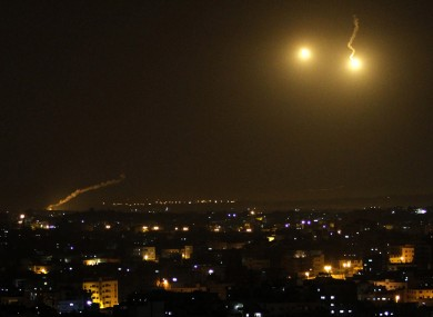 An Israeli illumination round is seen along the Israel and Gaza borders as it lights the sky east of Gaza City