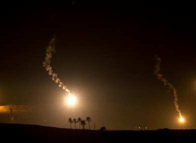 Smoke and flares of Israeli illumination rounds over the northern Gaza Strip as seen from the Israel Gaza Border in southern Israel