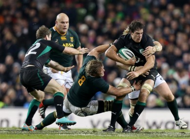 Mike McCarthy tests the Springbok defence with a charge.