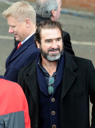 Eric Cantona and, behind, Peter Schmeichel at the ceremony.